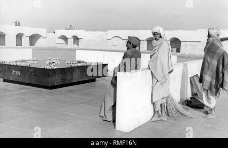 Visitors at the tomb of Mahatma Gandhi. The tomb, called Raj Ghat, is a cenotaph, since Gandhi's ashes were scattered in the Ganges and other waters. (undated photo) - Stock Photo