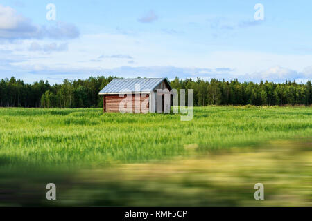 lonely house in the field - Stock Photo