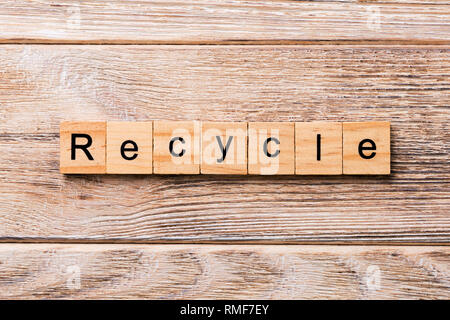 recycle word written on wood block. recycle text on wooden table for your desing, concept. - Stock Photo