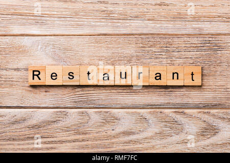 RESTAURANT word written on wood block. RESTAURANT text on wooden table for your desing, concept. - Stock Photo