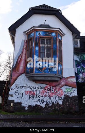 Krefeld, Germany. 11th Feb, 2019. 'Street Art Art' at a house on the banks of the Rhine in the district of Uerdingen, which was created by the street art artist 'Ketty Grossi' as part of the event 'Rhine Side Gallery 2018' of the city of Krefeld. Credit: Horst Ossinger/dpa/Alamy Live News - Stock Photo