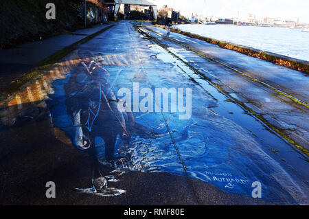Krefeld, Germany. 11th Feb, 2019. 'Street Art Art' on the promenade on the banks of the Rhine in the district of Uerdingen, which was created by the street art artist 'Marion Ruthardt ' during the event 'Rhine Side Gallery 2018' of the city of Krefeld. Credit: Horst Ossinger/dpa/Alamy Live News - Stock Photo