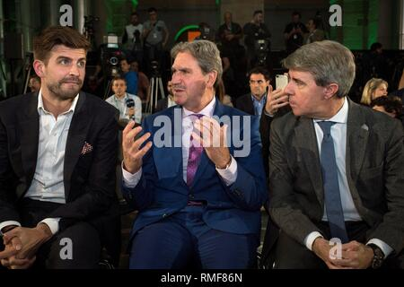 Madrid, Spain. 14th Feb, 2019. President and founder of Kosmos, FC Barcelona's soccer player Gerard Pique (L), President of the International Tennis Federation ITF, David Haggerty (C), and Madrid Regional President, Angel Garrido, during the Davis Cup quarters final draw held in Madrid, Spain, 14 February 2019. Davis Cup runs from 18 to 24 November 2019 in Madrid. Credit: Luca Piergiovanni/EFE/Alamy Live News - Stock Photo