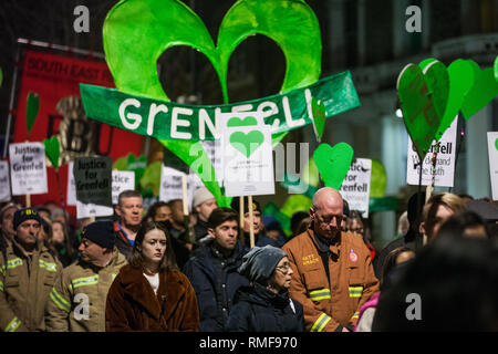 London, UK. 14th February, 2019. Matt Wrack, General Secretary of the Fire Brigades Union (FBU) joins members of the Grenfell community taking part in the Grenfell Silent Walk around North Kensington on the monthly anniversary of the fire on 14th June 2017. 72 people died in the Grenfell Tower fire and over 70 were injured. Credit: Mark Kerrison/Alamy Live News - Stock Photo