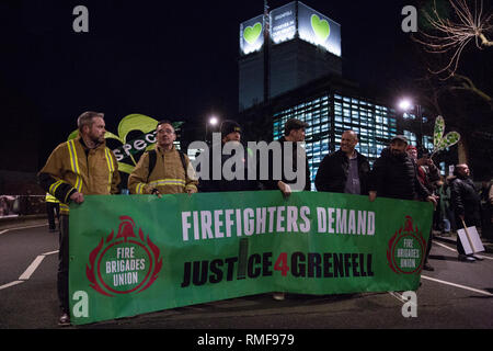 London, UK. 14th February, 2019. Firefighters prepare to take part in the Grenfell Silent Walk around North Kensington with the Grenfell community on the monthly anniversary of the fire on 14th June 2017. 72 people died in the Grenfell Tower fire and over 70 were injured. Credit: Mark Kerrison/Alamy Live News - Stock Photo