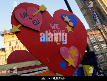 London, UK. 14th Feb, 2019. Placards are pictured outside the Houses of Parliament in London, Britain on Feb. 14, 2019. The British House of Commons on Thursday voted against a motion tabled by Prime Minister Theresa May reiterating its support for government Brexit approach. Credit: Han Yan/Xinhua/Alamy Live News - Stock Photo