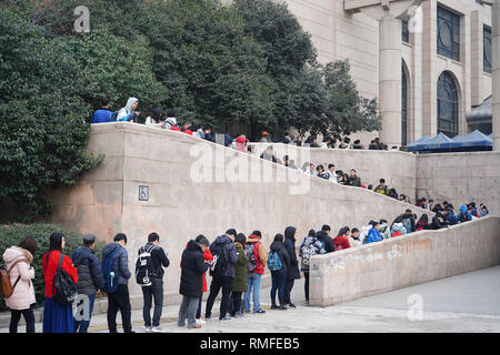 Xi'an, China's Shaanxi Province. 15th Feb, 2019. People line up to enter the Shaanxi Library in Xi'an, northwest China's Shaanxi Province, Feb. 15, 2019. Many teenagers came to the library to read and study during their winter holiday after the Spring Festival. Credit: Shao Rui/Xinhua/Alamy Live News - Stock Photo