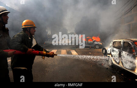 Jammu, Indian-controlled Kashmir. 15th Feb, 2019. Firefighters put out flames on a vehicle during a protest demonstration against a suicide attack on a paramilitary convoy, in Jammu, the winter capital of Indian-controlled Kashmir, Feb. 15, 2019. Authorities Friday imposed curfew in Jammu city following massive violence, officials said. The violence broke out during a shutdown call to the protest against the attack on paramilitary Central Reserve Police Force (CRPF) convoy in the restive region on Thursday that killed at least 40 people. Credit: Stringer/Xinhua/Alamy Live News - Stock Photo