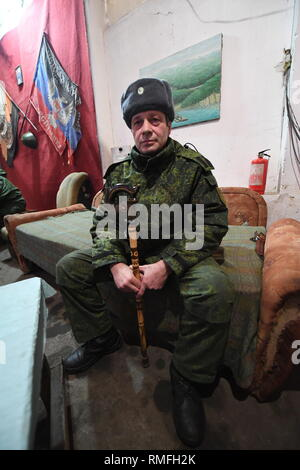 January 18, 2019 - Donetsk, Donetsk Peoples Republic (DPR) D, Ukraine - DPR soldier from the Shakhtyorsk division, called name, Arkadiy, seen relaxing between shifts in the division HQ.The war between the Ukrainian army and the soldiers of the Donetsk Peoples Republic has cost the lives of 12,000 people and those who have been displaced exceed a million. It escalated in 2014. Despite a ceasefire in place, it is evident that death still occurs from predominantly, sniper, mortar and mines.The construction of trenches either side of no-man's land, (often only 100mt apart) have ensured a stati - Stock Photo