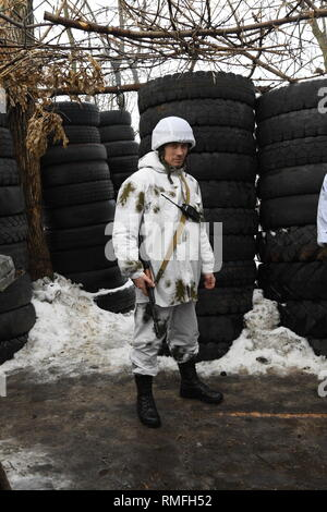 January 17, 2019 - Donetsk, Donetsk Peoples Republic (DPR) D, Ukraine - DPR soldier from the Shakhtyorsk Division seen living on the front line in a maze of tunnels and trenches, both above and below ground, some fortified with rubber tires.The war between the Ukrainian army and the soldiers of the Donetsk Peoples Republic has cost the lives of 12,000 people and those who have been displaced exceed a million. It escalated in 2014. Despite a ceasefire in place, it is evident that death still occurs from predominantly, sniper, mortar and mines.The construction of trenches either side of no-man - Stock Photo