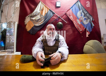 January 18, 2019 - Donetsk, Donetsk Peoples Republic (DPR) D, Ukraine - DPR soldier, called name, ''Baikal'', and captain of the Shakhtyorsk Division which patrol the frontline trenches on the DPR side some 5km from Donetsk city seen the company HQ.The war between the Ukrainian army and the soldiers of the Donetsk Peoples Republic has cost the lives of 12,000 people and those who have been displaced exceed a million. It escalated in 2014. Despite a ceasefire in place, it is evident that death still occurs from predominantly, sniper, mortar and mines.The construction of trenches either side of - Stock Photo