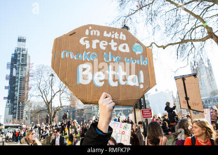 London, UK. 15th February, 2019. Thousands of students take part in a YouthStrike4Climate for Climate Day. After gathering in Parliament Square, students blocked streets around Westminster. Strike events involving schools all over the UK were organised by UK Student Climate Network and the UK Youth Climate Coalition to demand that the Government declare a climate emergency and take positive steps to address the climate crisis, including highlighting the issue as part of the school curriculum. Credit: Mark Kerrison/Alamy Live News - Stock Photo