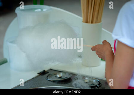 Woman is preparing candy floss in the park - Image - Stock Photo