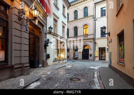Narrow cobbled street in old Riga, Latvia. - Stock Photo
