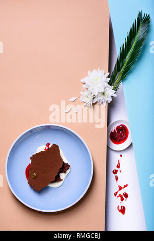 Chocolate souffle dessert, vanilla mousse with cherry jam. Top view, copy space. - Stock Photo