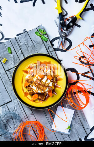 Carrot cake with caramel dip, delicious  dessert, modern style. Bakery product. Top view, copy space. - Stock Photo