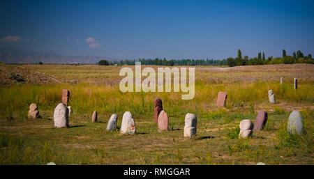 Kurgan stelae aka Balbals near the Berana tower in Tokmok,Chuy Valley Kyrgyzstan - Stock Photo