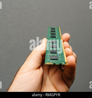 Man holding in hand new powerful RAM manufactured for servers nad workstations - Stock Photo
