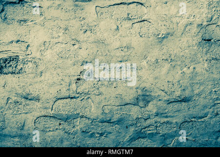 Old painted brick work, duo toned in yellow and blue - Stock Photo
