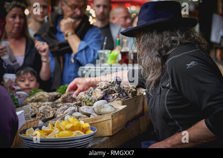 London, UK - June, 2018. A fishmonger stall selling raw oysters and shellfish in Borough Market, one of the biggest and oldest food market in London. - Stock Photo