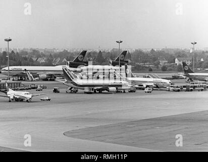 View of waiting aircrafts on the apron of the Munich Airport in Riem. - Stock Photo