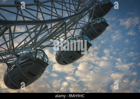 London, UK - April, 2018. Pods of the London Eye, a giant Ferris wheel on the South Bank of the River Thames. - Stock Photo