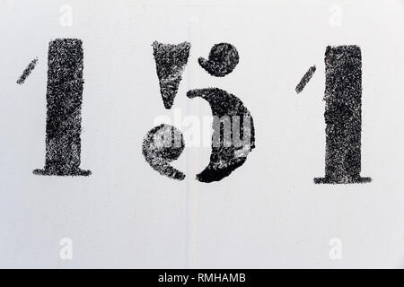 one hundred fifty one, number one hundred fifty one painted stencil on white backdrop - Stock Photo