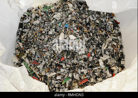 GERMANY, Hamburg, recycling of electronical scrap and old consumer goods at company TCMG, the trash is collected by the urban waste disposal system and than processed and separated here after metals like copper and plastics for further recycling and reuse, by law is not allowed to export e-scrap to africa and other countries, recycled metal granulate - Stock Photo