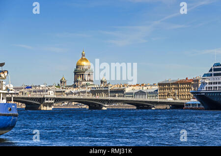 Saint Petersburg, Russia -  June 27, 2018: Saint Isaac's Cathedral behind the Blagoveshchenskiy bridge and the river Bolshaya Neva with the maritime t - Stock Photo
