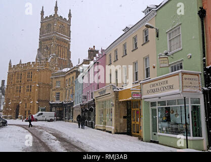 Winter snow in the market place, Cirencester town centre, Gloucestershire Cotswolds, South West England, UK - Stock Photo