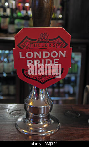 Fullers London Pride hand pump on a bar / pub, North West England, Best bitter, CAMRA ale alcoholic beverage, brewed in Chiswick, West London - Stock Photo