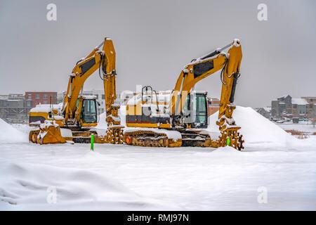 Snowy excavators during winter in Daybreak Utah - Stock Photo