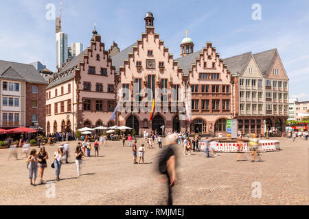 Frankfurt - Germany, Roemerberg, May 26th 2018, people walking on Frankfurt historic townhall square Roemerberg in front of the Roemer on a sunny spri - Stock Photo