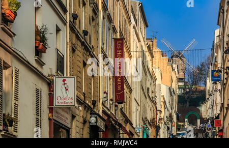 Paris, France - January 22, 2015: View along the street onto to old restaurant with windmill Moulin de la Galette in the Montmartre district - Stock Photo
