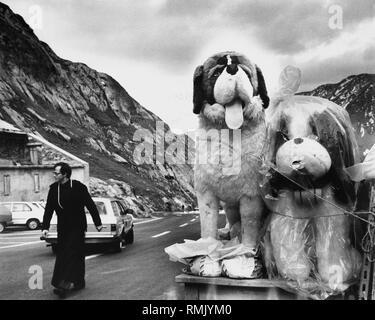 The Great St Bernard Pass in Switzerland. On the right two big stuffed St. Bernard dogs. - Stock Photo