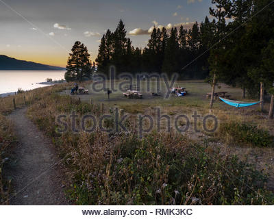 Picnic tables at swimming beach, Colter Bay, Grand Teton National Park, Teton County, Wyoming, USA - Stock Photo