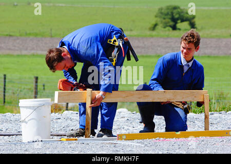 Builders mark out the profile for a building at a construction site in Westland, New Zealand - Stock Photo