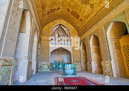 ISFAHAN, IRAN - OCTOBER 21, 2017: The North hall of Jameh Mosque with scenic muqarnas decoration, fine brickwork, Islamic patterns and calligraphy, on - Stock Photo