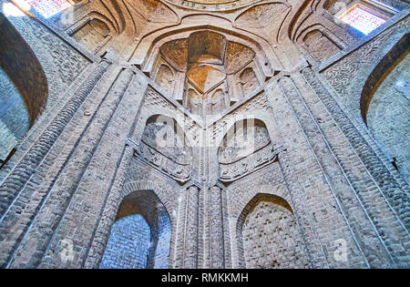ISFAHAN, IRAN - OCTOBER 21, 2017: The carved brick wall of the shabestan of Jameh Mosque with niches, relief patterns, Islamic calligraphy and pillars - Stock Photo