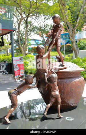 Bronze Sculpture of children playing in Orchard Rd, Singapore