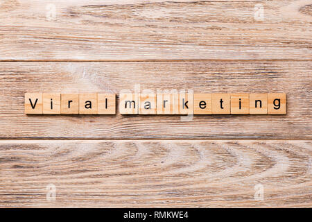 Viral markeing word written on wood block. Viral markeing text on wooden table for your desing, concept. - Stock Photo