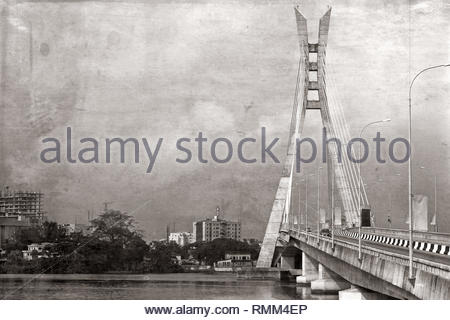 Lekki, Lagos, Nigeria; Lekki bridge shown in black and white, with grunge look - old retro photo effect - Stock Photo