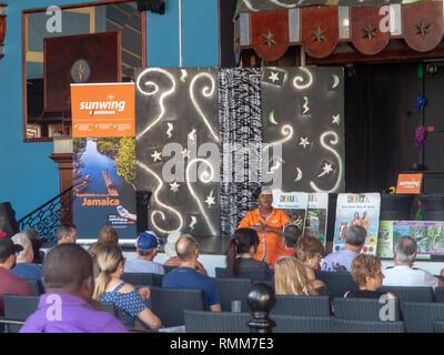 Ocho Rios Jamaica - 5 February 2019: Tourist Guide making presentation to Tourists - Stock Photo