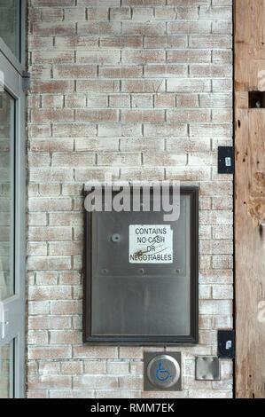 Security drop box in brick wall - Stock Photo