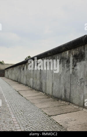 View of a section of the original east-west Berlin wall, part of the Berlin Wall Memorial at Bernauer strasse, Berlin, Germany. - Stock Photo