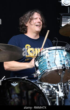 Drummer Steve Gorman is shown performing on stage during a 'live' concert appearance with Trigger Hippy. - Stock Photo