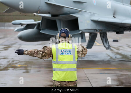 Ground crew signal an RAF Tornado jet fighter for take-off at RAF Lossiemouth base, Moray, Scotland - Stock Photo
