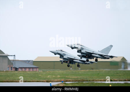 Two RAF Tornado jet fighters taking off in tandem at RAF Lossiemouth base, Moray, Scotland - Stock Photo