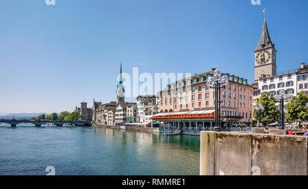 Switzerland, Canton Zürich, view of the Old Town of Zürich from River Limmat with the prominent Storchen Hotel, St. Peter Church and Fraumünster Churc - Stock Photo