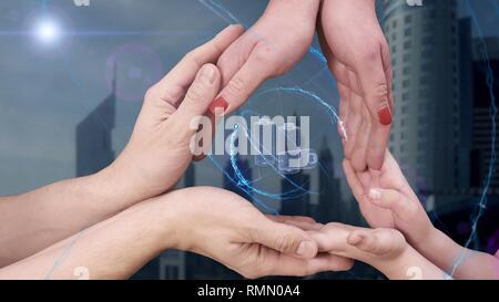 Men's, women's and children's hands show a hologram 3D Batteries - Stock Photo